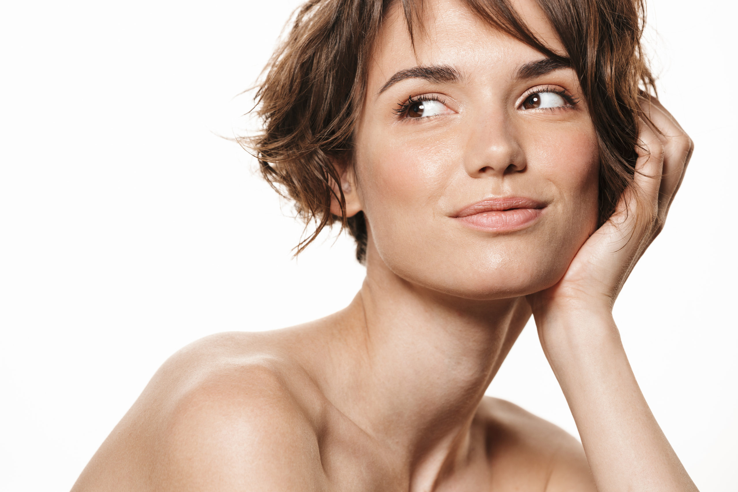 Beauty portrait of a lovely young topless woman demonstrating wrinkle treatments for the face and neck by Dr Django Nathan at Medical Injectables in Wollongong and Orange NSW